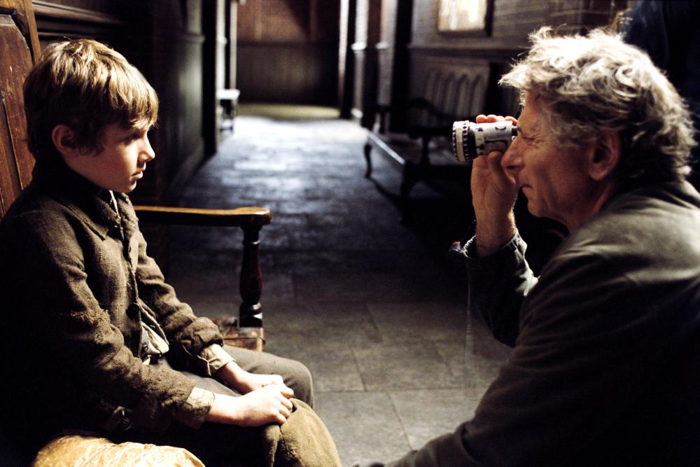 OLIVER TWIST, Barney Clark, director Roman Polanski on set, 2005, (c) Columbia